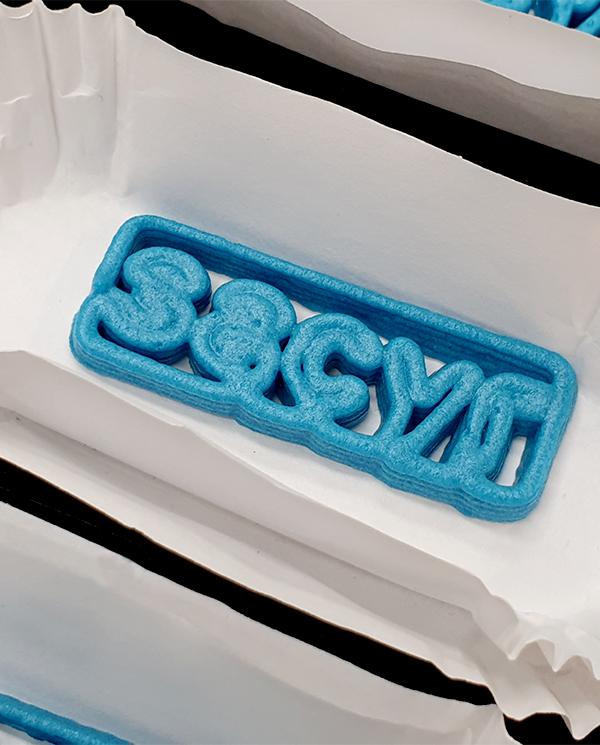 Sacyr, bombon con su logo impreso en 3D con chocolate